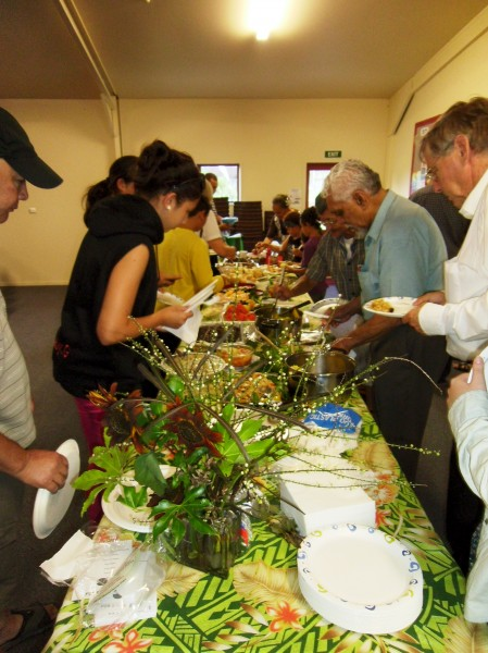 sharing a harvest meal at  the WIC celebration